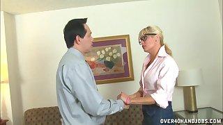 Blonde slut Mikki Lynn drops on her knees to make a balls-up of off her boss